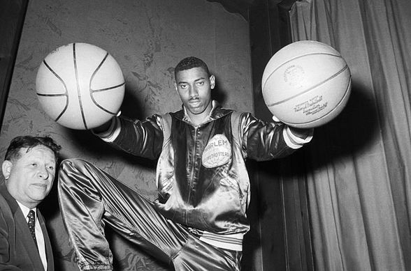 Wilt Chamberlain Holding Two Basketballs